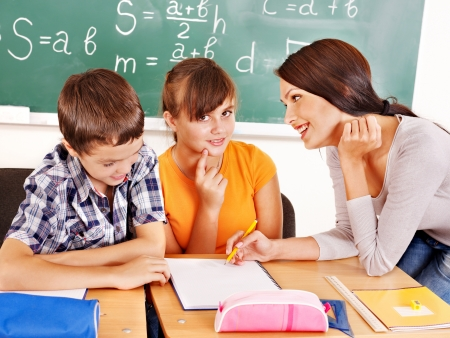School child with teacher in classroom. Stock Photo - 15232978