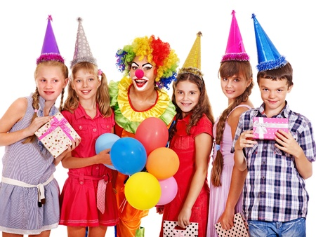 Birthday party group of teen people with clown. Isolated. Stock Photo - 15232722