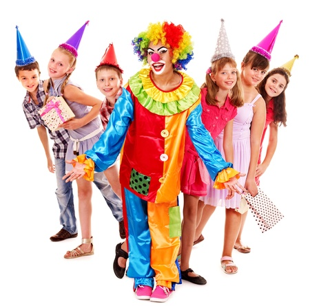 Birthday party group of teen people with clown. Isolated. Stock Photo - 15231657