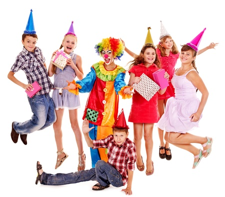 children party: Birthday party group of teen people with clown. Isolated.