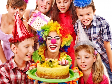 Birthday party of group teen with clown and cake. Isolated. photo