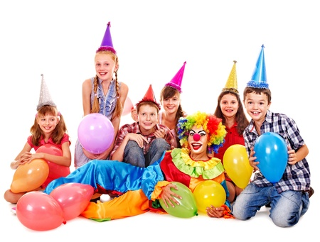 Birthday party group of teen people with clown. Isolated. Stock Photo - 15232232