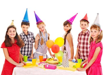 Birthday party of group teen with cake. Isolated. Stock Photo - 15231529
