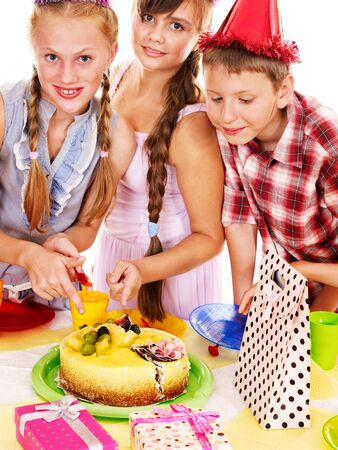 Birthday party of group teen with cake. Isolated. Stock Photo - 15232977