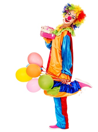 carnival clown: Portrait of clown with balloon and gift box. Isolated. Stock Photo
