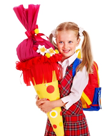 first day of school: Child holding gift school cone. Isolated.