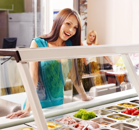 Women at cafeteria buying food. Stock Photo - 15232484