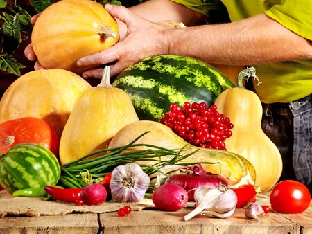 Male hands preparing vegetable on wooden boards. photo