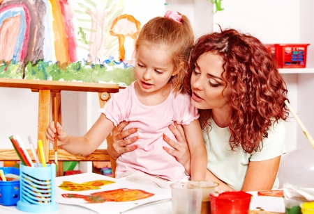 kids class: Child with mother painting . Child care.
