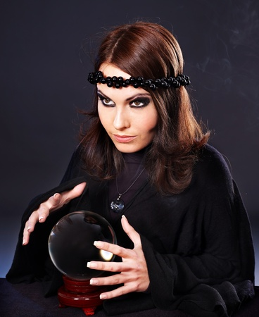 clairvoyance: Woman wearing black with crystal ball. Fortune telling.