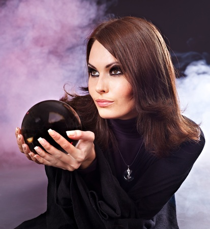clairvoyant: Young woman with crystal ball. Fortune telling.