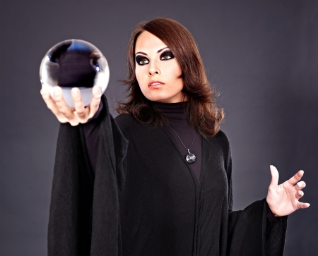 psychic: Woman holding crystal ball. Fortune telling.