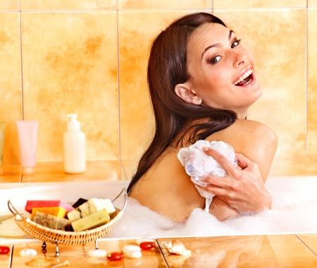 Young woman take bubble  bath. Skincare. photo