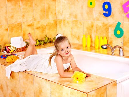 Little girl washing in bubble bath . Stock Photo - 15290451