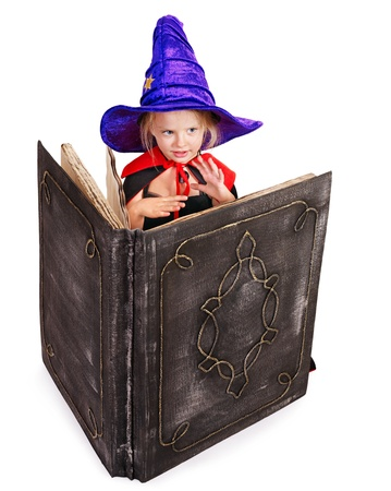 Happy girl wearing witch hat holding  book. Stock Photo - 15290474