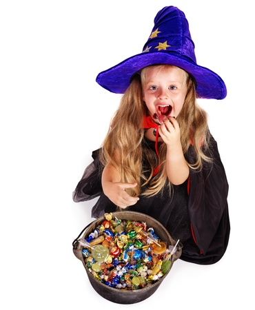 caldron: Witch  little girl with group candy. Halloween. Stock Photo