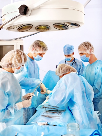 Team surgeon at work in operating room. At work. photo