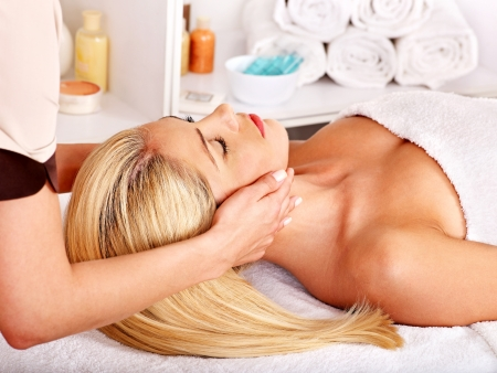 day spa: Blond woman getting head massage.