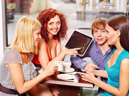 girl notebook: Group people using tablet computer at cafe .