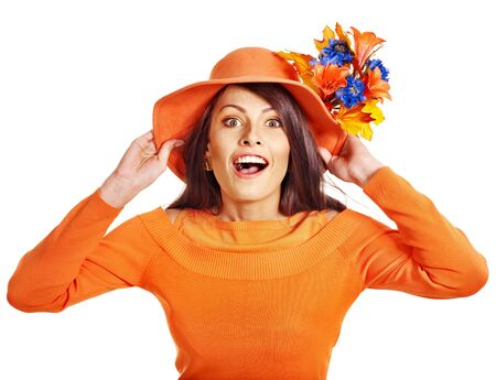 Woman wearing orange sweater and hat. Isolated. Stock Photo - 15290442