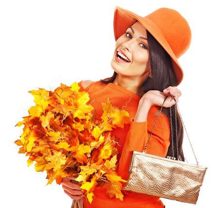 Woman holding  orange leaf and handbag. Autumn fashion. Stock Photo - 15300380
