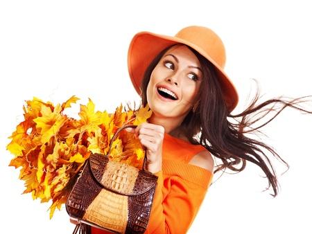 Woman holding  orange leaf and handbag. Autumn fashion. Stock Photo - 15290226