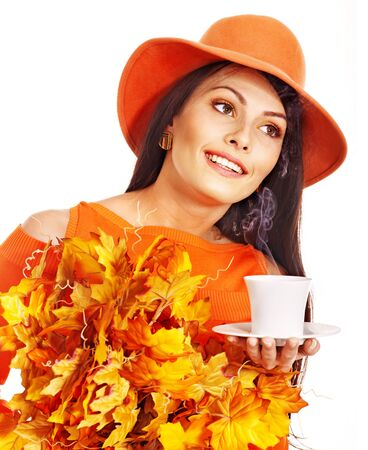 Woman holding  cup of coffee and orange leaves. Stock Photo - 15290452