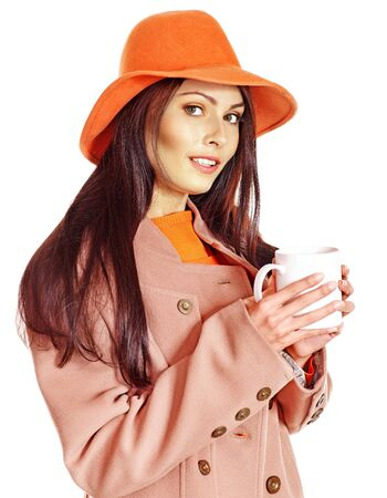 Woman holding  cup of coffee and orange leaves. Stock Photo - 15290492