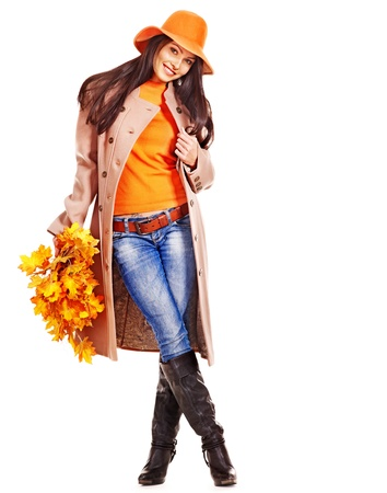 denim jacket: Woman wearing overcoat holding  orange leaves. Stock Photo