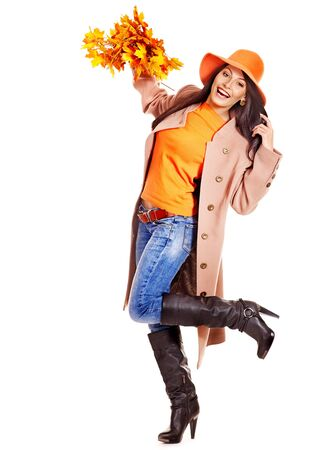 Woman wearing overcoat holding  orange leaves. Stock Photo - 15290217