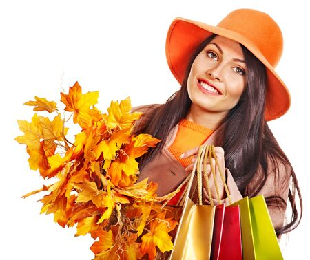 Woman wearing autumn overcoat and hat holding shopping bag. Stock Photo - 15290285