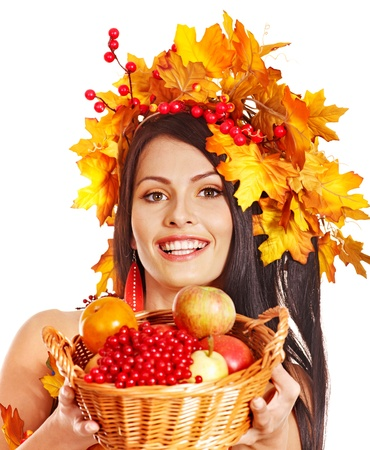 Girl with wreath of autumn leaves holding basket with fruit. Stock Photo - 15290231