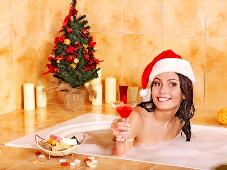 bathroom woman: Woman in santa hat relax in bath. Christmas concept.