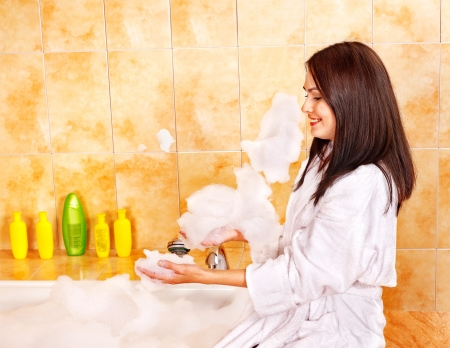 vaporarium: Young woman take bubble  bath. Indoor.