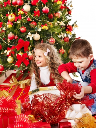 group of christmas baubles: Children with gift box near Christmas tree. Isolated. Stock Photo