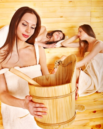 Group people relaxing in sauna. photo