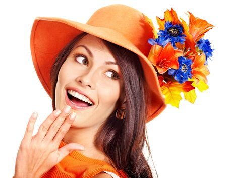 Happy woman wearing orange hat with flower. Autumn fashion photo
