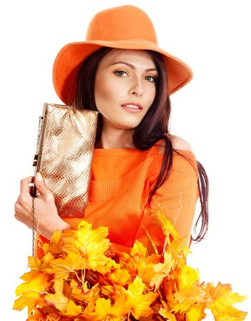Woman holding  orange leaf and handbag. Autumn fashion. Stock Photo - 15455340
