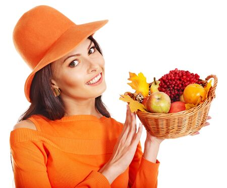Woman holding autumn basket with fruit and vegetable. Stock Photo - 15455288