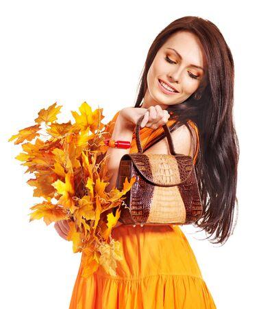 Woman holding  orange leaf and handbag. Autumn fashion. Stock Photo - 15455346