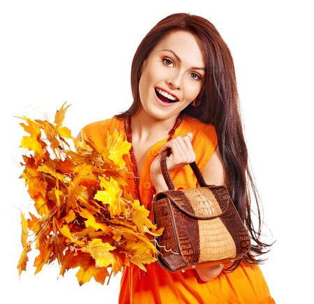Woman holding  orange leaf and handbag. Autumn fashion. Stock Photo - 15455512