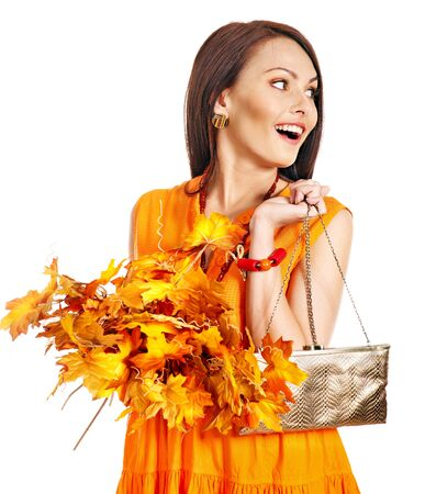 Woman holding  orange leaf and handbag. Autumn fashion. Stock Photo - 15455353