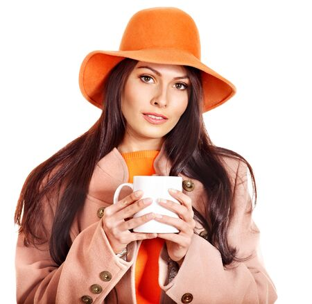 Woman holding  cup of coffee and orange leaves. Stock Photo - 15455281