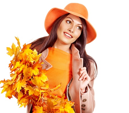 Woman wearing overcoat holding  orange leaves. Stock Photo - 15455291