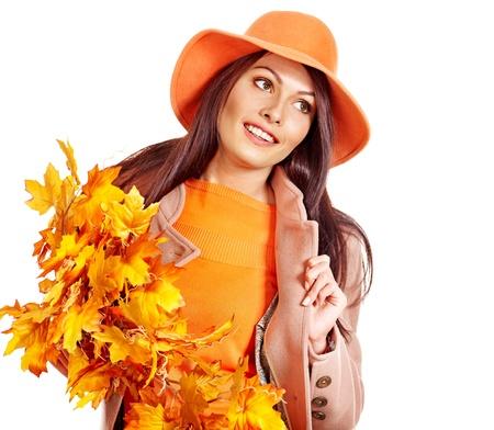 Woman wearing overcoat holding  orange leaves. Stock Photo - 15455291