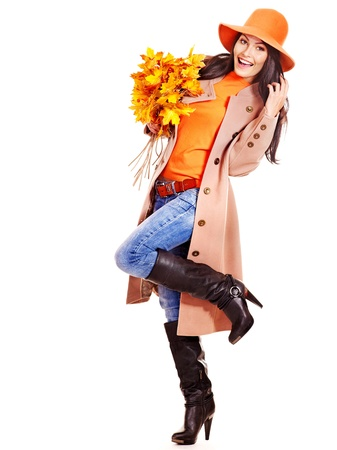 Woman wearing overcoat holding  orange leaves. Stock Photo - 15455280