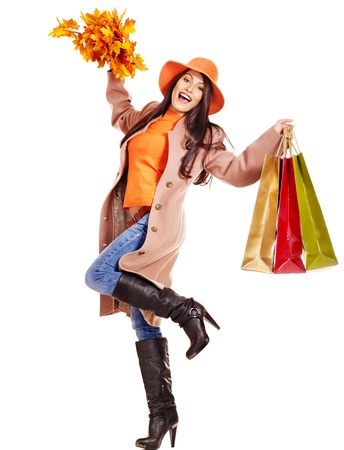 autumn hair: Woman wearing autumn overcoat and hat holding shopping bag.