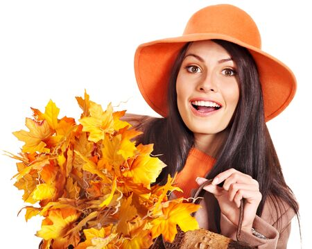 Woman wearing overcoat holding  orange leaves. Stock Photo - 15455610