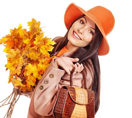 Woman holding  orange leaf and handbag. Autumn fashion. Stock Photo - 15455347