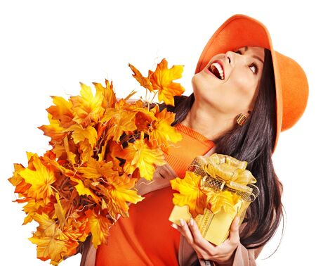 Woman holding  orange leaf and handbag. Autumn fashion.